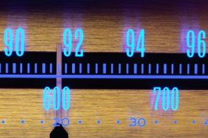10786739 - 70�s old radio dial close-up with glowing scale numbers